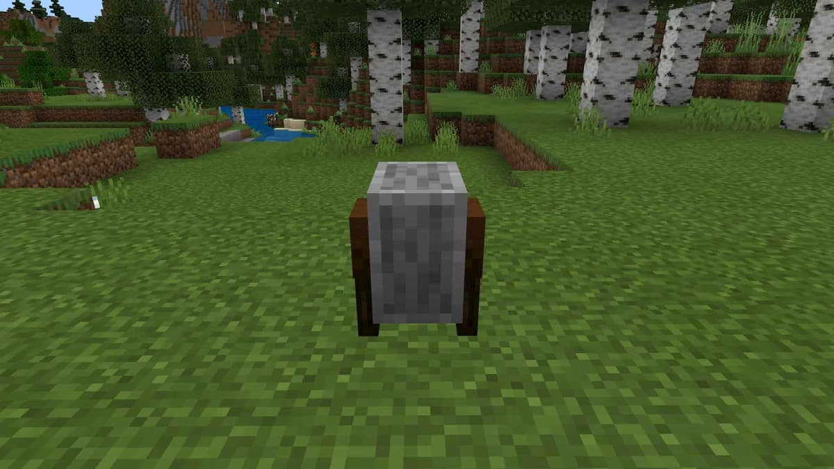 How to make and use a grindstone in Minecraft
